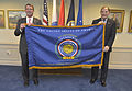 Defense Secretary Ash Carter, left, presents Veterans Affairs Secretary Robert A. McDonald with a commemorative flag marking the 50th anniversary of the Vietnam War during an office call at the Pentagon, June 2 150629-D-NI589-218.jpg