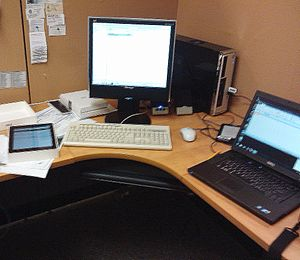 Librarian - A librarian's workspace at Newmarket Public Library in 2013. iPad, PC, eReader and laptop computer are required tools.