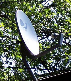 Directv satellite on house roof.jpg