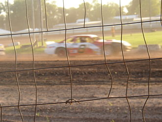 "Dirt track racing - A typical dirt track ""street stock"" car racing in Wisconsin, USA"