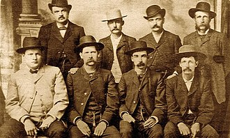 United States Marshals Service - Bat Masterson (standing second from right), Wyatt Earp (sitting second from left), and other deputy marshals during the Wild West era.