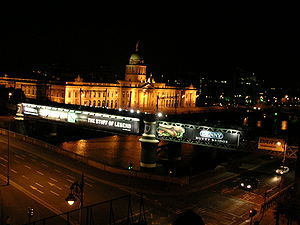Loopline Bridge - Loopline bridge at night (prior to removal of advertising hoardings), with Butt Bridge in foreground, and Custom House in background