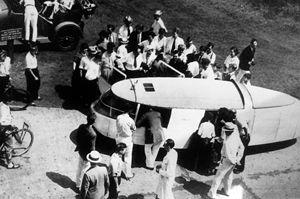 Dymaxion car - The Dymaxion car, c.1933, artist Diego Rivera shown entering the car, carrying coat