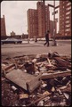 EMPTY LOT STREWN WITH TRASH AT 108TH STREET AND LEXINGTON AVENUE, MANHATTAN - NARA - 549784.tif
