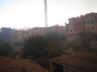 Edificios tras el humo en Vilagarcía.jpg