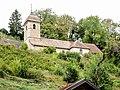 Eglise Saint-Nicolas, vue du village de Belvoir.jpg