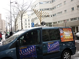 Jewish outreach - Local Chabad house drives around Paris to get Jewish people interested in Hanukka services
