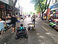 Electric toy cars in pedestrian zone around Hoan Kiem.jpg