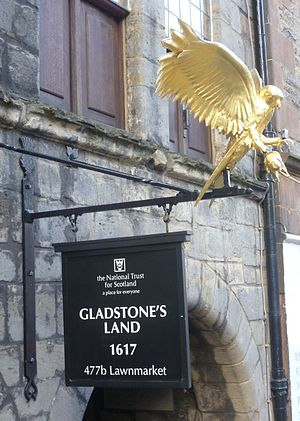 """Gladstone's Land - The entrance sign with a """"gled"""" hovering above"""