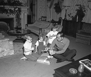 Washington Governor's Mansion - Governor Daniel J. Evans with his children in a residential room of the mansion during Christmas 1969