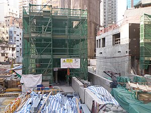 Exit A1 of Sai Ying Pun Station under construction in April 2014.JPG