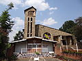 Exterior of Genocide Memorial Church with Never Again Display in Foreground - Karongi-Kibuye - Western Rwanda.jpg