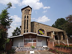 Exterior of Genocide Memorial Church with Never Again Display