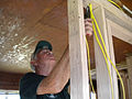 FEMA - 41677 - Volunteer doing electrical work in Alaska.jpg