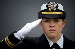 Salute - A U.S. Navy officer performs a military hand salute.