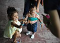 Flickr - Official U.S. Navy Imagery - Children chase bubbles outside the family medicine exam room during Continuing Promise 2011.jpg