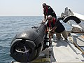 Flickr - Official U.S. Navy Imagery - Civilian contractors secure an M18 Mod 2 Kingfish unmanned underwater vehicle..jpg