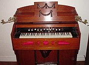 A harmonium. Operation of the two large pedals at the bottom of the case supplies wind to the reeds.