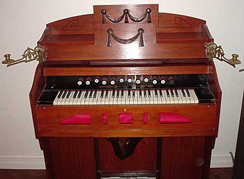 A harmonium. Operation of the two large pedals...