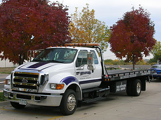 Flatbed truck - Ford F-650 flatbed tow truck