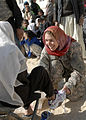 GI gives donated American shoes to an Afghan orphan in Zabul -a.jpg