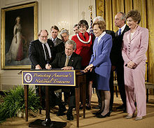 George W. Bush signing proclamation to establish the monument on June 15, 2006 George W. Bush approves Northwestern Hawaiian Islands Marine National Monument.jpg