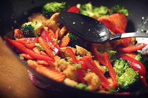 Stir frying - A ginger chicken stir fry in a wok