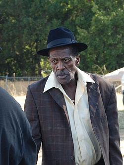 Gregory Isaacs SNWMF 2010 2 - discussing (cropped).jpg