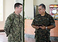 Guatemalan Ship's Capt. Saul Arnoldo Tobar Garcia, right, the second in command of the Guatemalan Marine Brigade, presents a gift of appreciation to U.S. Navy Lt. Sean Tucker, assigned to Coastal Riverine 140822-N-XQ474-219.jpg