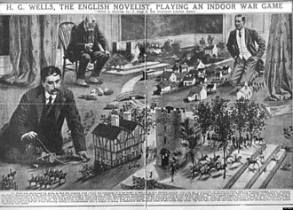Little Wars - H. G. Wells playing a wargame with W. Britain toy soldiers according to the rules of Little Wars.  Wells is using a piece of string cut to a set length of the distance his soldiers can move.  An umpire sits in a chair with his stopwatch timing Wells.  Wells' opponent waits for his turn to move and fire his cannon at Wells' soldiers.