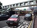 HK CWB 銅鑼灣 Causeway Bay 高士威道 Causeway Road footbridge red taxi July 2019 SSG 02.jpg