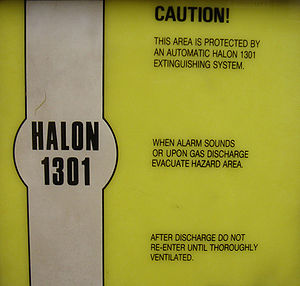 Bromotrifluoromethane - Halon 1301 hazard sign, with instructions upon gas discharge.