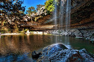Hamilton Pool Preserve - A waterfall flows freely into Hamilton Pool, which is surrounded by a collapsed grotto