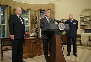 Michael Hayden (general) - George W. Bush announces his nomination of Hayden as the next Director of the CIA as Director of National Intelligence John Negroponte looks on.