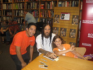 Brian Welch - Brian Welch (middle) signing his autobiography Save Me From Myself (2007)