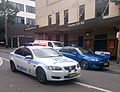Holden Commodore Omega marked patrol car and Ford Falcon XR6 Turbo unmarked police car (11662485575).jpg
