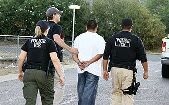 Arrest - A man arrested by ICE agents