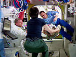 ISS-42 EVA-2 (c) checking out the spacesuit helmet.jpg