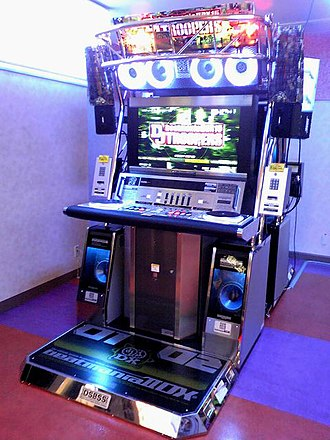 Beatmania IIDX - A cabinet running beatmania IIDX 15 DJ TROOPERS