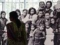 Indian Woman with Images of Tibetan Children - Tibet Museum - Tsuglagkhang Complex - McLeod Ganj - Himachal Pradesh - India (26708088331).jpg