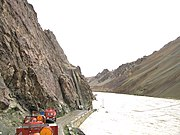 A flooded Indus river inundates the Srinagar-Kargil-Leh highway.
