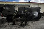 Joint forces decontaminate the flight line 071317-M-PY134-517.jpg