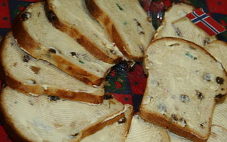 """Norwegian butter crisis - Norwegian traditional Christmas sweet bread called julebrød or julekake (""""Christmas bread/cake"""") sliced and spread with butter."""