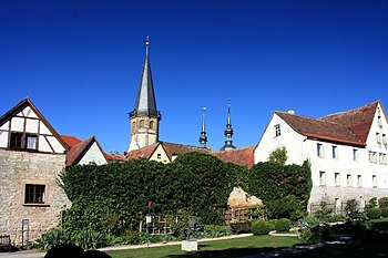 The kitchen garden of Weikersheim with the city wall, in the background the church of St. Georg