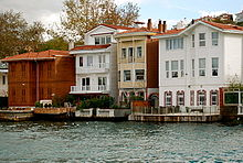 Two- and three-story colored houses with docks and balconies, built directly on the edge of the water