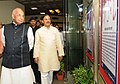 "Kaptan Singh Solanki and the Minister of State for Culture and Tourism (Independent Charge), Dr. Mahesh Sharma visiting an exhibition, at the ""Inaugural Function of Birth Centenary of Nanaji Deshmukh"", in New Delhi.jpg"