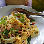 Khua chin som sai khai is a dish prepared with dry-fried pickled pork and egg. Chin som is the northern Thai name for naem.