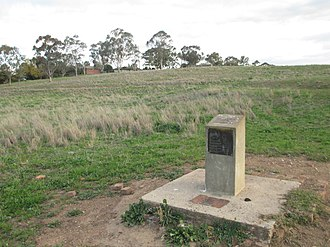 Calala, New South Wales - The cement-block marker for Killala, the first house constructed in the Calala area after European settlement. It sits in a field on the northwest outskirts of Calala.
