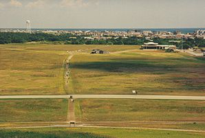 Kitty Hawk (in the foreground the former airfield on the beach at Kill Devil Hills)