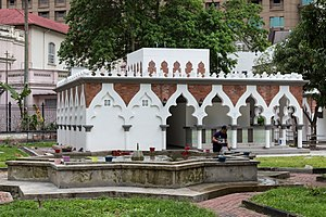 Ghusl - Wudu and ghusl facilities (in background) at Jamek Mosque in Kuala Lumpur, Malaysia